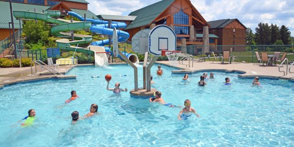 Kids playing basketball at the outdoor waterpark