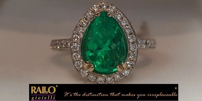 18KT two tone gold, Pear shape Colombian emerald with diamonds.