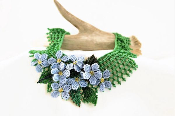 Beaded Blue Forget me not Flowers on a bead netted base.