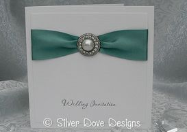 Glamour pearl and diamante wedding invitation with satin ribbon