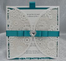 Opulence laser cut wedding invitation with satin Dior style ribbon and heart diamante embellishment