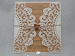 Rustic charm laser cut wedding invitation finished with wooden heart and twine