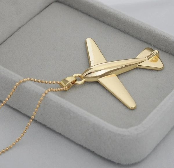 Golden airplane pendant necklace