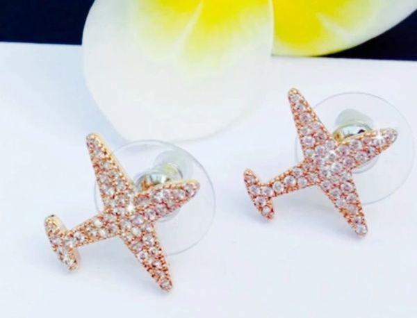 Airplane stud golden earrings