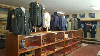 a collection of military uniforms and military memorabilia