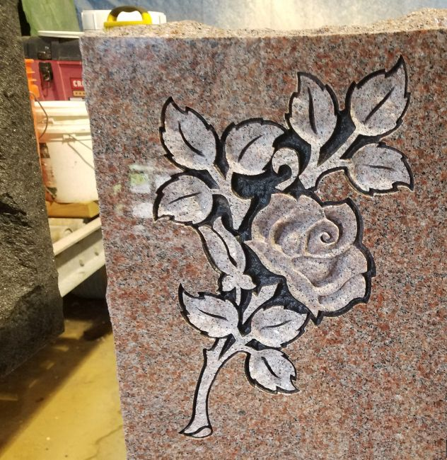 Mountain rose red granite memorial with a custom deep carved rose