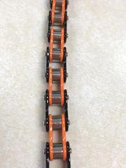 Small Orange and Black Bike Chain
