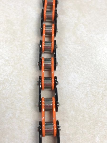 Small Orange and Black Bike Chain