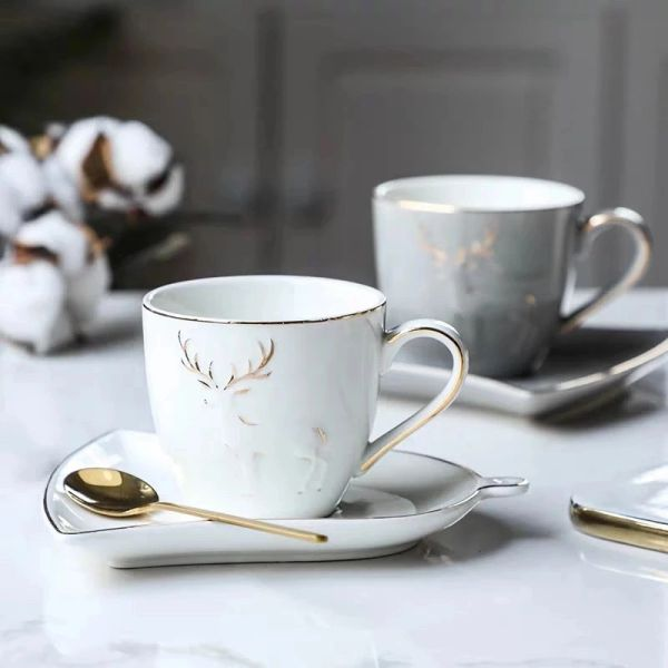 Ceramic Coffee / Tea Cup with a ring shape saucer and golden spoon