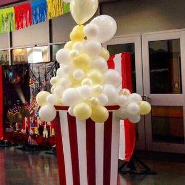 Creative Balloon designs can enhance any themed event like this High-School carnival