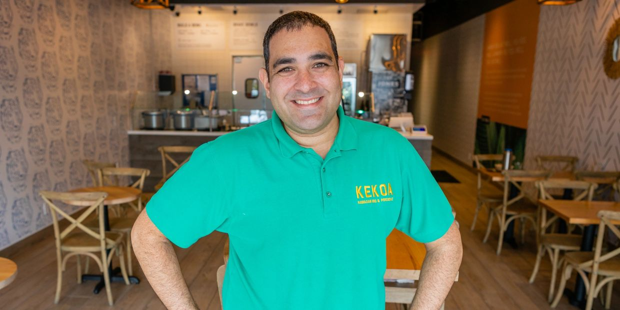 David Obadia with Kekoa dining area in the background ready to serve you fast with a smile