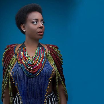 African body accessories worn by LEDISI. Emfri is a beautiful African cape made with carefully selected African prints. It is sure to make you standout, whether it's for a day or an evening event.  This adorable cape is adjustable with a knot at the back  African Necklace, Celebrity Picks, Rope Necklace, Tribe Favs Tags: African accessories, Ankara Necklace, AS18 Collection, body jewelry, rope jewel, Rope necklace