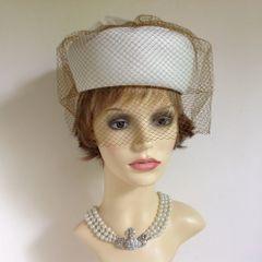 Kangol Vintage 1960s Ivory Pillbox Hat Tan Over Net Veil Rosette & Ties To Rear