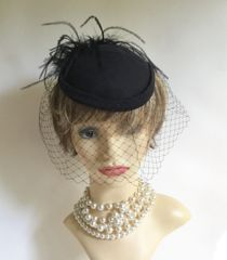 Vintage 1960s Black Fabric Pillbox Small Capulet Hat Face Net And Rear Plumage