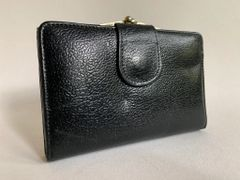 Black Textured Leather 1960s Vintage Coin Purse Wallet With Black Leather Lining With Faded Gold Toned Frame And kiss clasp.