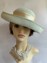 BALFOUR Polyester Pale Green Formal Dress Hat With Rear Flowers Along With Peach Ribbon & Bow