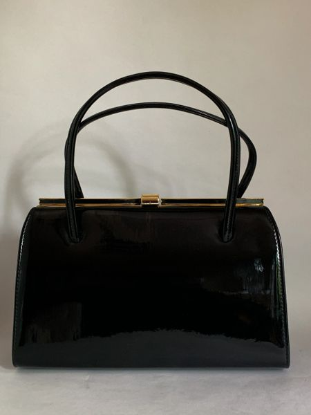 Vintage 1960s Black Faux Patent Handbag With Buff Suede Lining And Elbief Frame