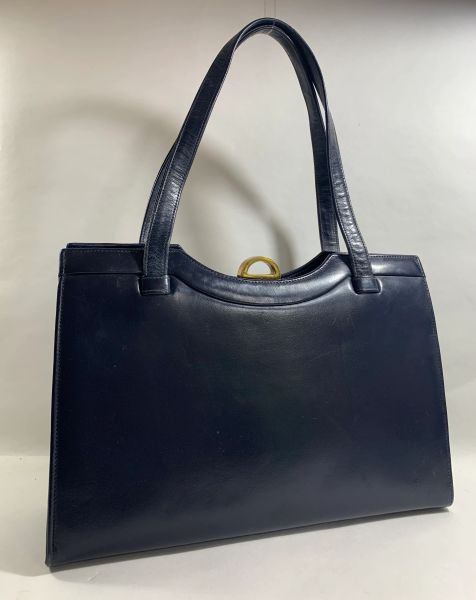 ST Vintage 1960s Blue Leather Handbag With Two Hidden Side Pockets Along With A Blue Fabric Lining And Single Sided Vanity Mirror