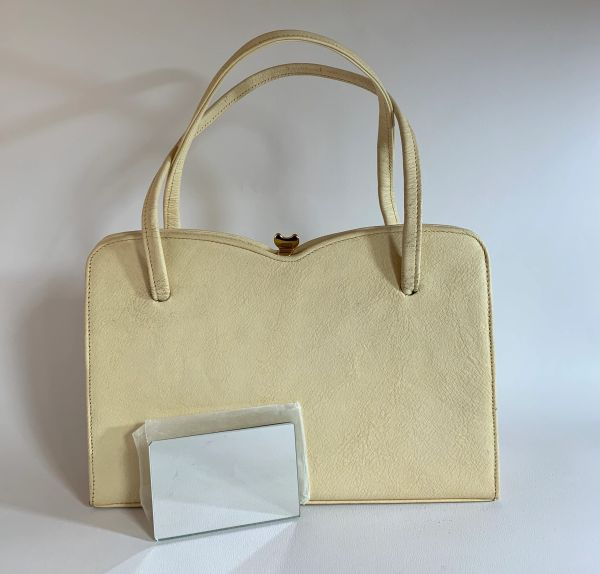 Ivory Leather 1960s Vintage Handbag Kelly Bag With Sweetheart Top With Buff Suede Lining And Vanity Mirror In Original Paper
