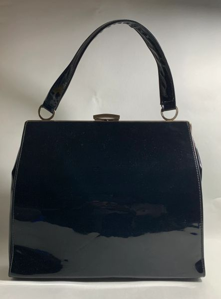 Vintage Large 1960s Soft Black Vinyl Faux Patent Handbag With Black Fabric Lining And Gold Tone Frame
