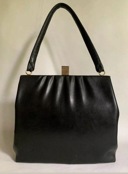 Vintage 1960s Soft Black Vinyl Handbag With Black Fabric Lining And Gold Tone Frame