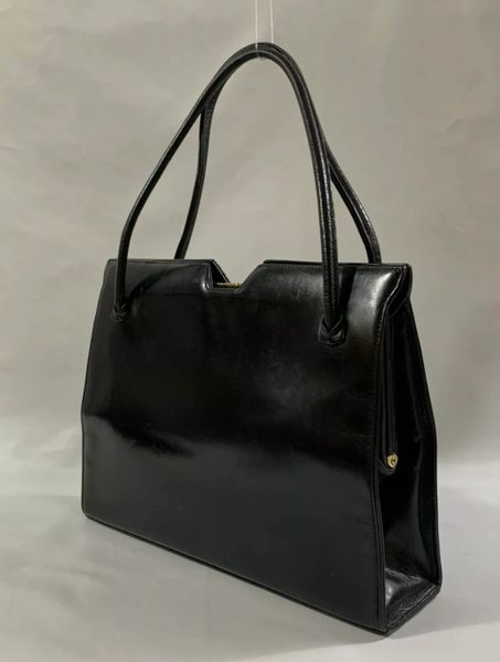 Waldybag Black Calf Leather 1960s Vintage Handbag With Buff Suede LIning And Gold Tone Clasp.