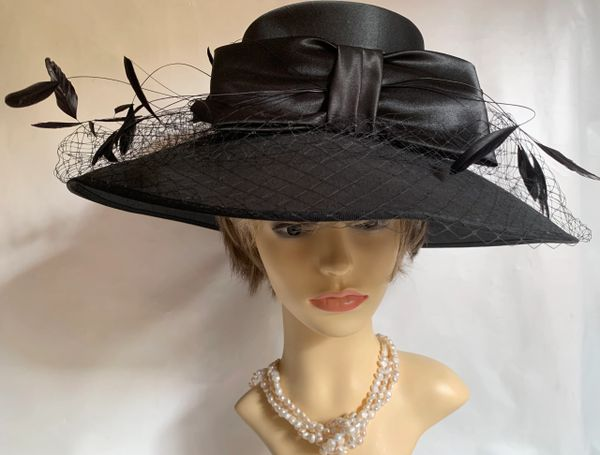 Fashion Line Genevieve Louis Black Polyester Formal Dress Hat With Large Bow Net & Feather Detail to Front.