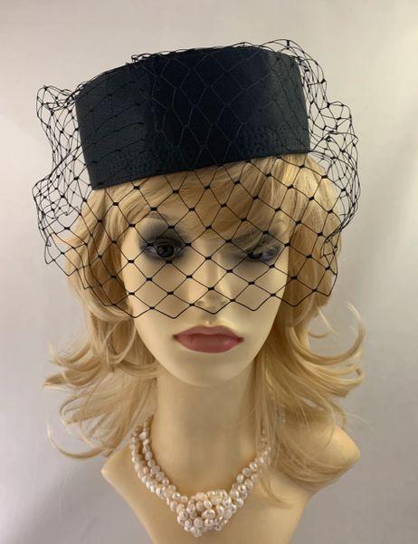 Vintage 1960s Black Polyester Satin Pillbox Hat Black Net Veil And Greenish Black Rear Bow Detail Fully Lined