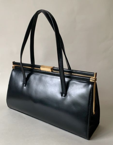 Vintage 1960s Black Leather Handbag With Buff Suede Lining And Elbief Frame