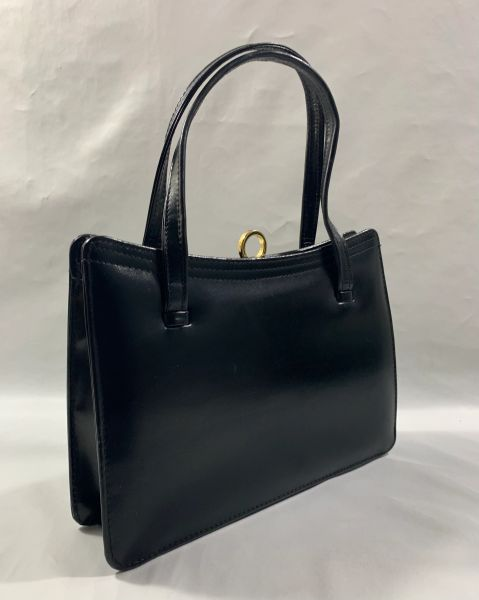Czarina Black Calf Leather 1960s Vintage Handbag With Dark Buff Suede LIning And Gold Tone Clasp.