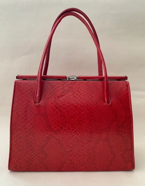 Vintage 1960s Handbag In Red Snake Embossed Faux Leather With Black Fabric Lining.