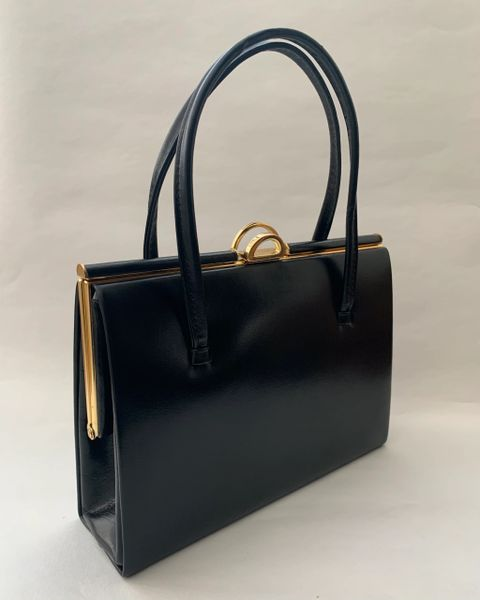 Vintage 1950s Black Leather Handbag With Buff Suede Lining And Elbief Frame