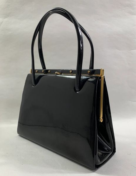Chamelle Black Faux Patent Vintage 1950s Handbag With Black Fabric Lining & Elbief Frame And Stud Detail.