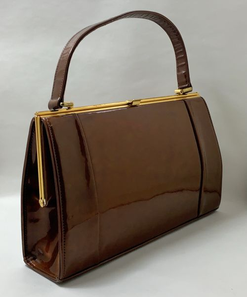Holmes Vintage 1960s Patent Bronze Handbag With Brown Fabric Lining And Elbief Frame