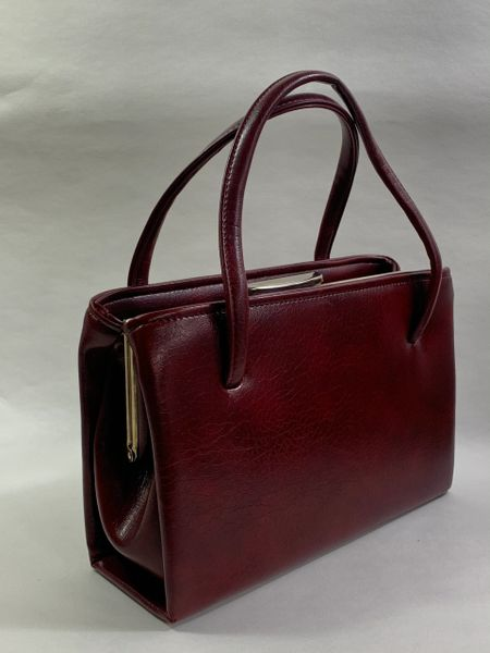 Vintage 1950s Synthetic Claret Granny Handbag Fabric Lining With Mid Brown Fabric Interior And Gold toned fittings and frame.