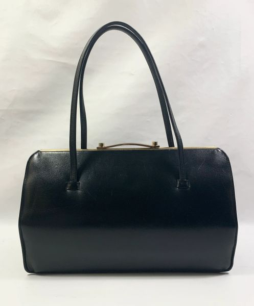 The Martin Vintage 1950s Black Calf Leather Handbag With Buff Suede Lining.