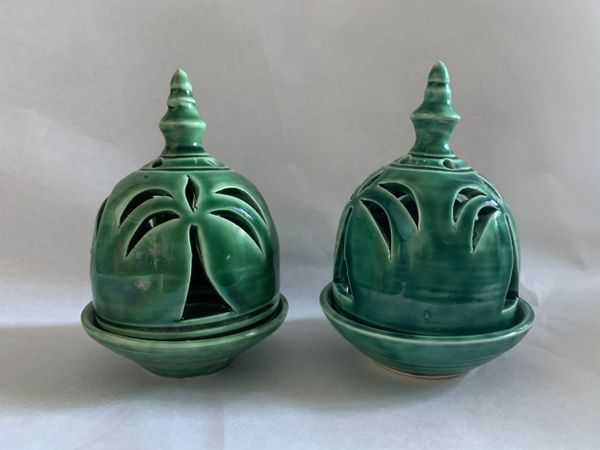 Two Ceramic Emerald Green Small Tea Light Candle Holders With Palm Tree Cut Outs..