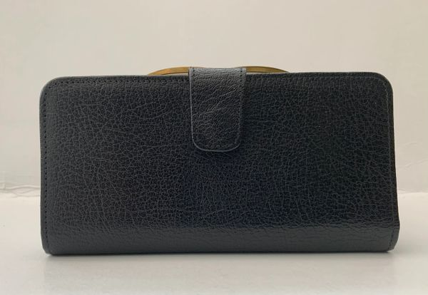 Black Textured Goats Leather 1950s Vintage Coin Purse Wallet With Leather outer and inside lining Brass Frame and kiss clasp.