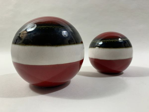 Two Decorative Red Brown White Striped Ceramic Carpet Balls One Large One Small