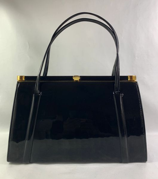 Black Faux Patent Vintage 1950s Handbag With Black Fabric Lining & Elbief Frame And Stud Detail.