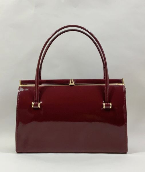 Vintage 1960s Claret Burgundy Faux Patent Handbag With Buff Suede Leather Lining And Elbief Frame