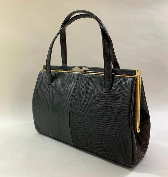 Fassbender at Lanca A 1950s Well Loved Black Lizard Skin Suede Lined Vintage Handbag.