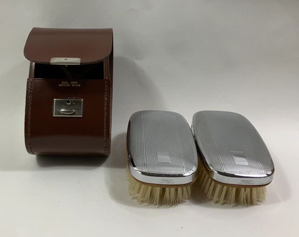 Vintage 1950s Chromium Plated Hair Brushes In A Chestnut Brown Leather Hide Case.