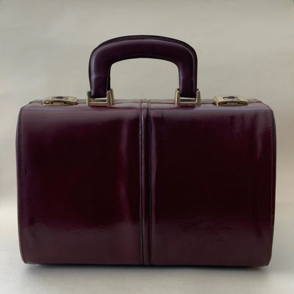 Vintage 1980s Burgundy Leather Vanity Travel Train Case With Patterned Ivory Vinyl Lining.