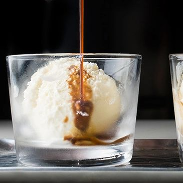 Vanilla ice cream scoop in a glass with a shot of espresso. Affogato