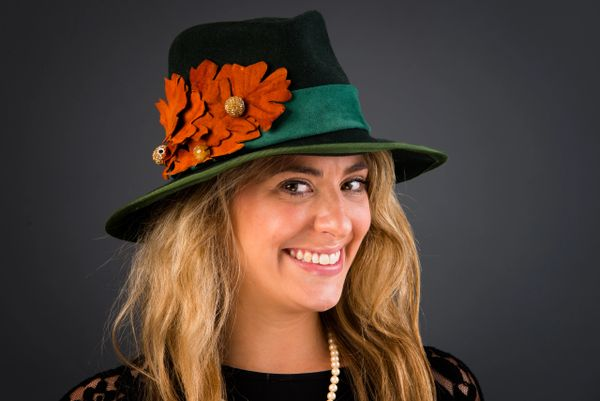 Green wool felt fedora with green suede hatband and hand tooled leather leaves