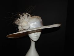 Kentucky Derby White Sinamay hat with white Hand tooled flowers and feathers