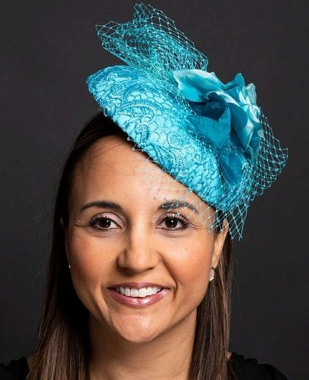 Turquoise Leather and Lace percher hat with silk flower and netting