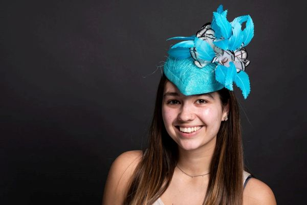 Abaca Scrunch and Sinamay Percher Hat in turquoise with feathers