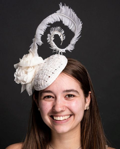 Tear Drop Percher of Woven Hemp Braid, feather, and Hand Tooled Flowers